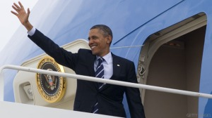 US President Barack Obama waves from Air